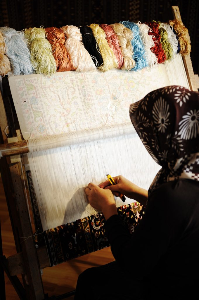 woman-weaving-a-carpet